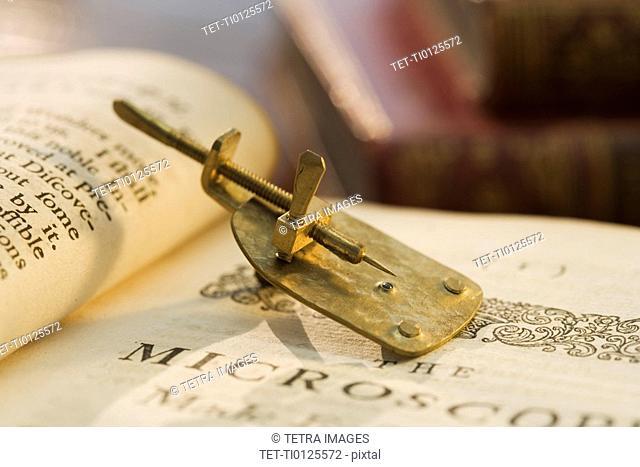 Model of Leeuwenhoek microscope on book