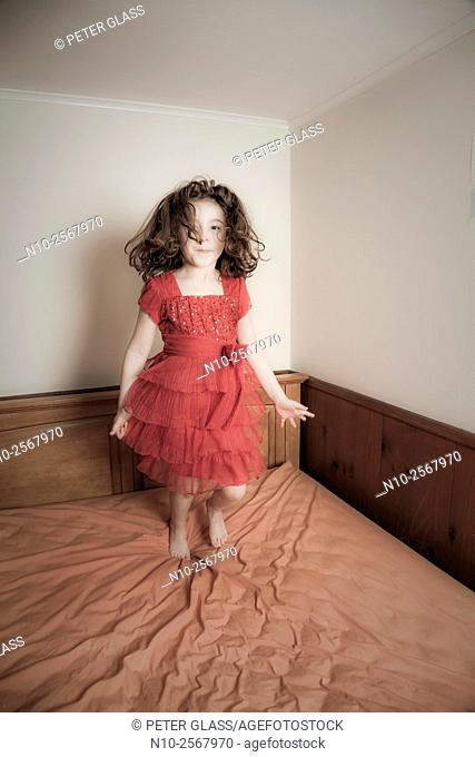 Six year old girl on her bed