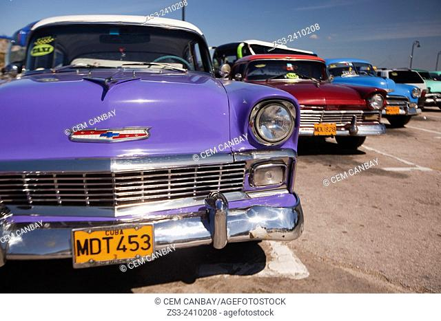 Colorful vintage American cars near Malecon in Old Havana, Cuba, West Indies, Central America