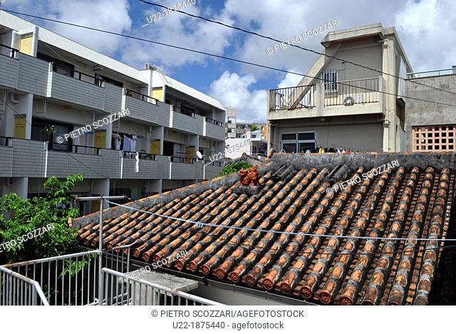 Naha, Okinawa, Japan, Shisa statuette on a house roof in Yorimiya neighborhood  Shisa is a traditional Ryukyuan decoration from Okinawan mythology resembling a...