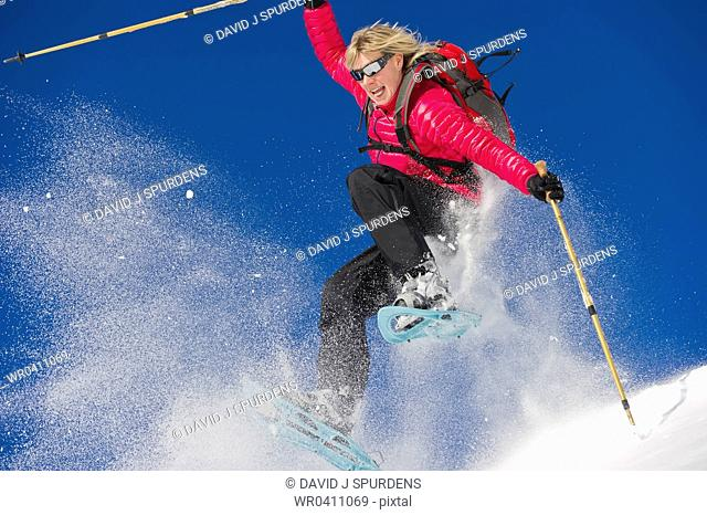 Having fun and snowshoeing through deep fresh powder snow