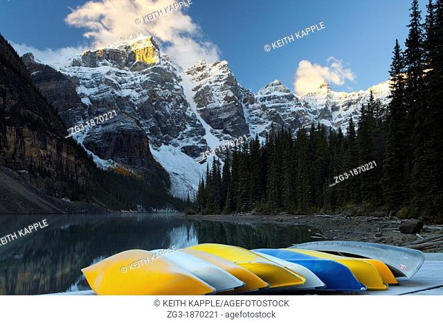 Rows of multi colored canoes at Moraine Lake, Banff National park, Canada