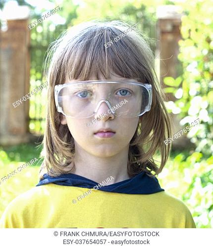 Portrait of a Boy in Protective Glasses Outdoors