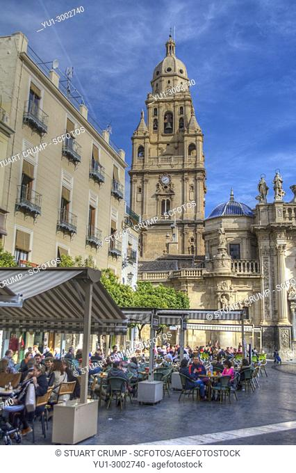 HDR image of the cafes and patron in front of Murcia Cathedral and bell tower in Spain