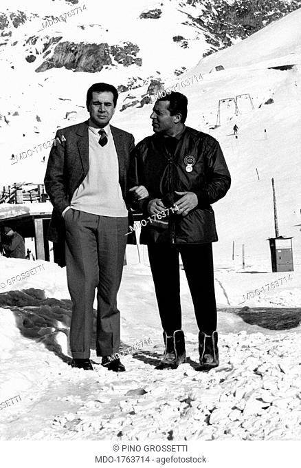 Achille Compagnoni and Enzo Tortora on the snow. On the snow in the occasion of a ski club meeting, Italian mountaineer Achille Compagnoni talks to the...