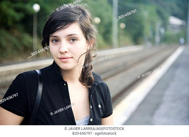 18 year old girl at train station. Legazpi, Guipuzcoa, Basque Country, Spain