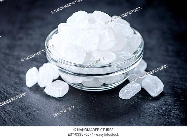 Slate slab with white rock sugar (selective focus; close-up shot)