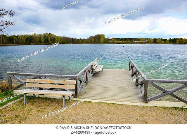 Landscape of a jetty with benches at the Murner See in Germany
