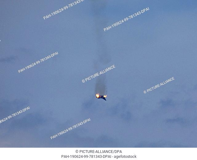 "24 June 2019, Germany (German), Malchow: A burning airplane of the type """"Eurofighter is to be seen in the sky over the small town at the Mecklenburg Lake..."