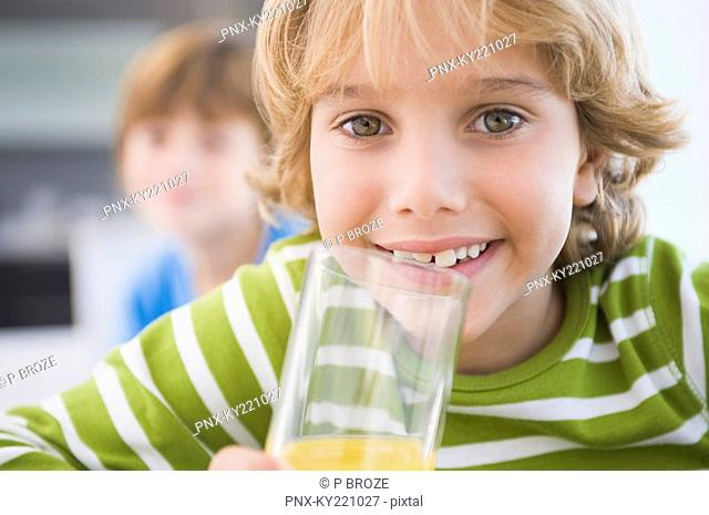 Boy drinking a glass of juice