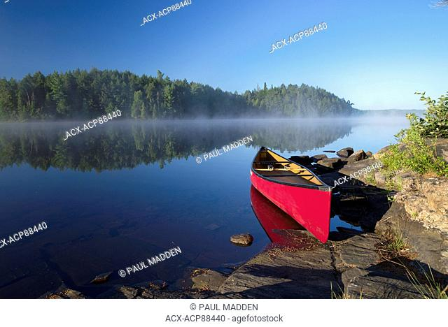 Middle aged Woman canoeing, Head Lake, Algonquin Park, Ontario, Canada