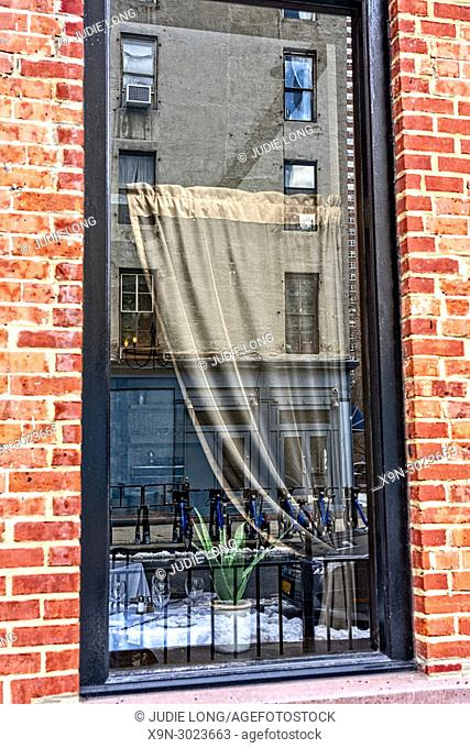 Looking at a Restaurant Window and Curtain on the Inside and Street reflections on the Outside. New York City, Manhattan, Tribeca