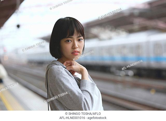 Young Japanese woman at a train station