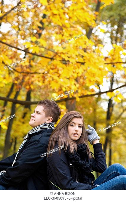 Young couple sitting in park Debica, Poland