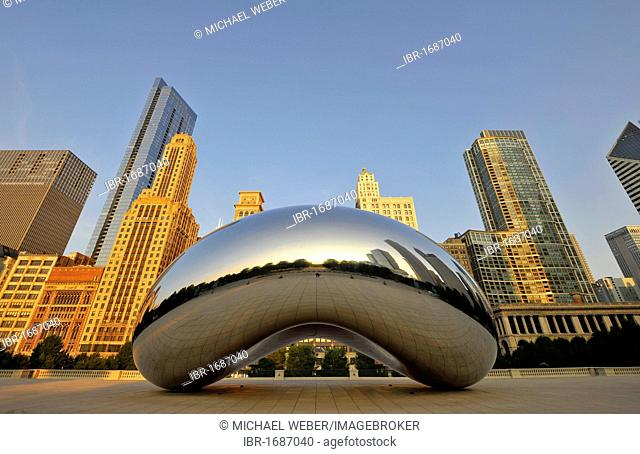 Cloud Gate sculpture, nicknamed The Bean, created by Anish Kapoor, in front of the skyline with Legacy at Millennium Park Building, The Heritage