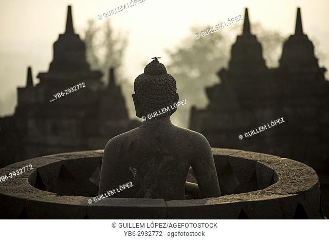 Buddha statue at the Borobudor temple in Java, Indonesia