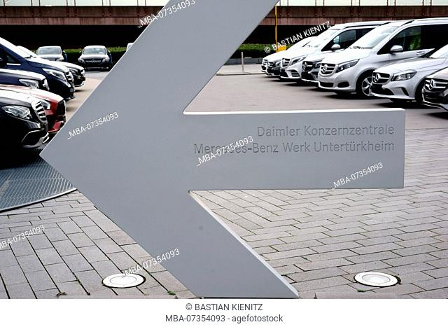 Directional arrow to the Daimler headquarter of the Mercedes-Benz plant Untertürkheim on the forecourt of the Mercedes Benz Museum in Stuttgart