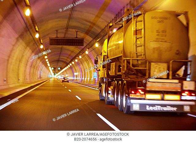Truck and cars on highway tunnel. Basque Country. Spain