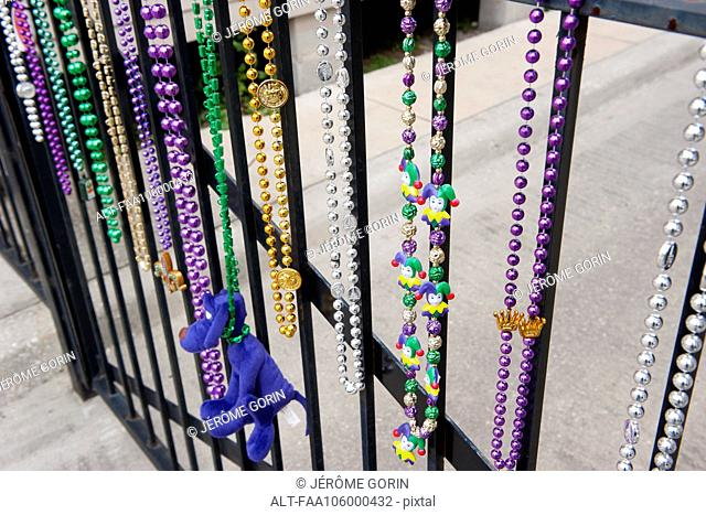 Mardi gras beads hanging on railing in New Orleans, Louisiana, USA