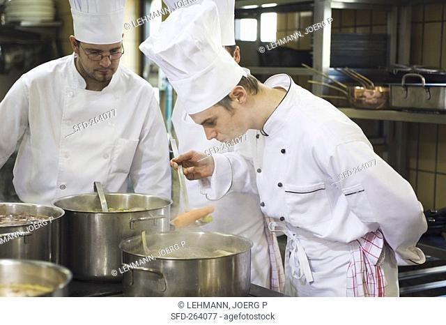 Chef checking a cooked carrot