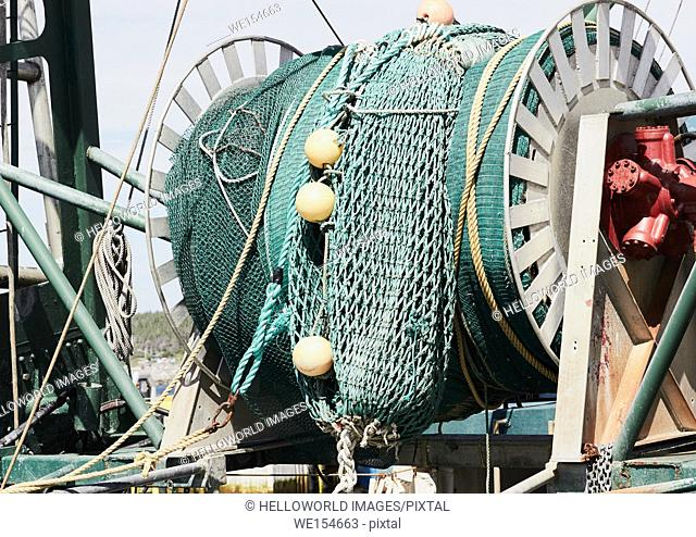 Giant roll of fish nets on trawler, Port au Choix, Newfoundland, Canada. . Known as the fishing capital of western Newfoundland it is also a designated National...