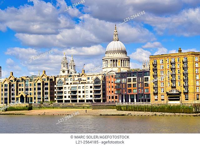 Saint Paul's Cathedral and buildings viewed across the river Thames from bankside in the City Of London. London, England, United Kingdom
