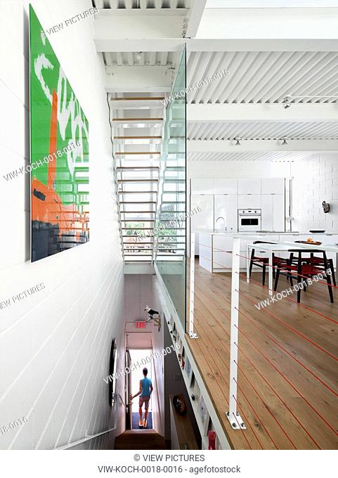 Owner descending the stairs from the living room to the street level entrance. 174 Grand Street, New York, United States