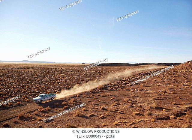 USA, Arizona, Pick up truck going through desert on Route 66
