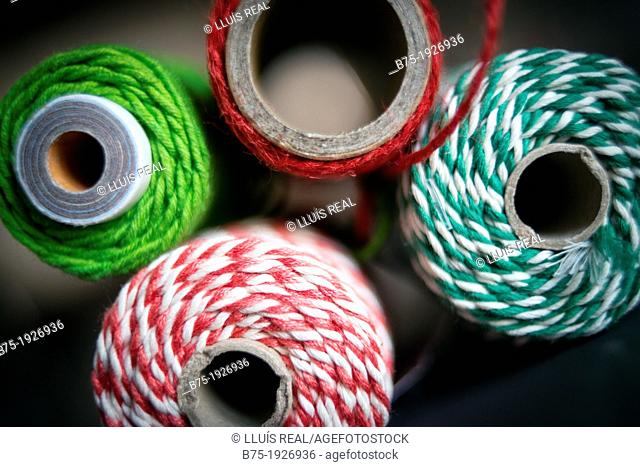 Rolls of different colored string