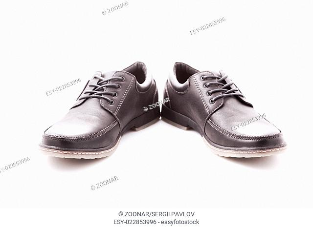 men's leather shoes with laces on a white background. close-up