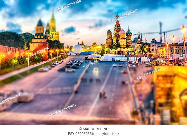 Scenic view of the Red Square, St. Basil's Cathedral and Kremlin walls during the blue hour at dusk, Moscow, Russia. Tilt-shift effect applied