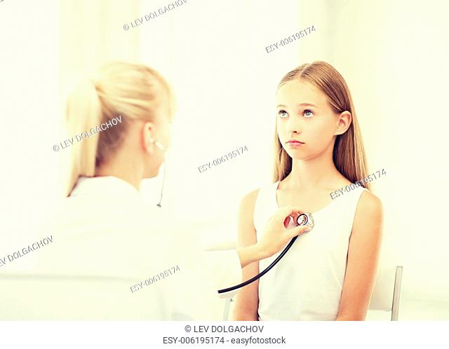 healthcare and medical concept - doctor with stethoscope listening to child chest in hospital