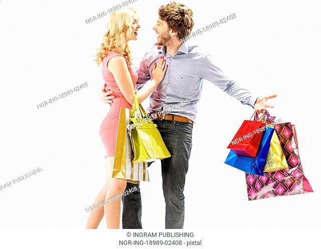 Laughing young couple enjoying the shopping