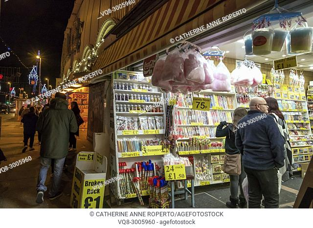 Blackpool rock and candy store with bags of candy floss, sugar lollies and canes by the famous illuminations of Blackpool's Golden Mile, Blackpool, England