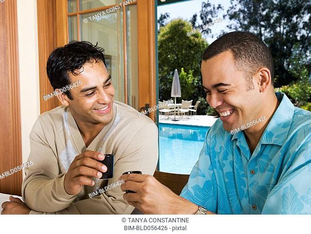 Multi-ethnic men toasting with sake