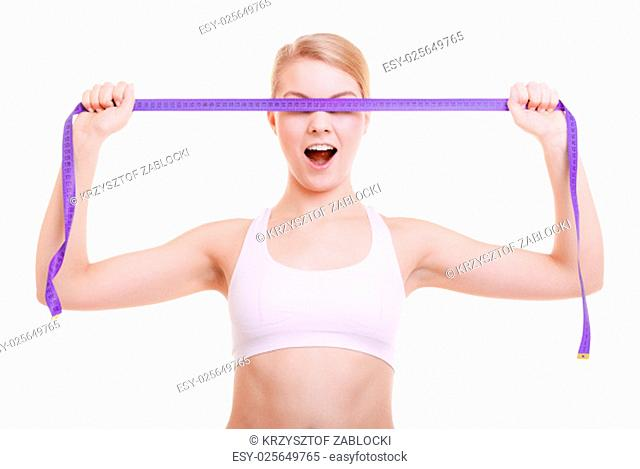 body care diet weight loss concept. fitness girl sporty woman covered her eyes with violet measuring tape face expression isolated on white background