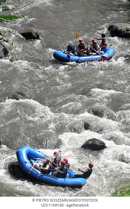 near Ubud (Bali, Indonesia): Taiwanese tourists rafting along the Ayung river, by the Sayan paddies