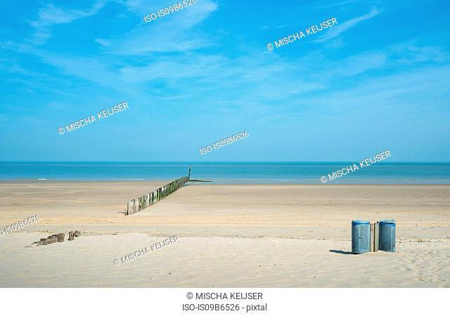 Waste bins and breakwater on beach, Cadzand, Zeeland, Netherlands, Europe