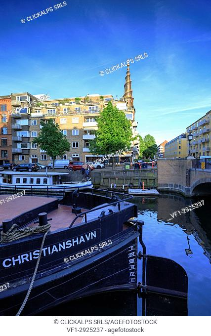Boats and tourist ferry moored in Christianshavn Canal, Copenhagen, Denmark