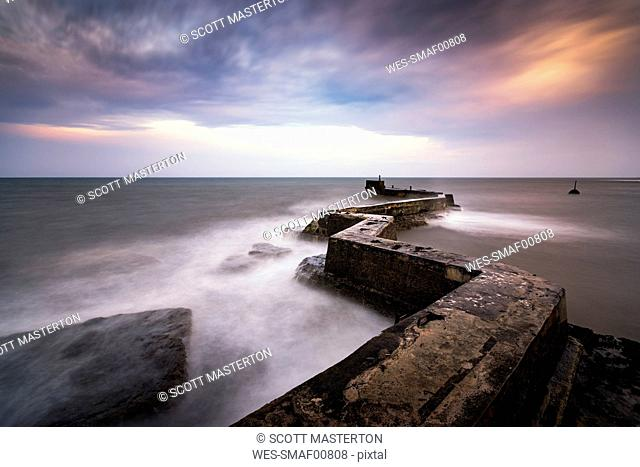 UK, Scotland, Fife, St Monans, breakwater at stormy day, long exposure