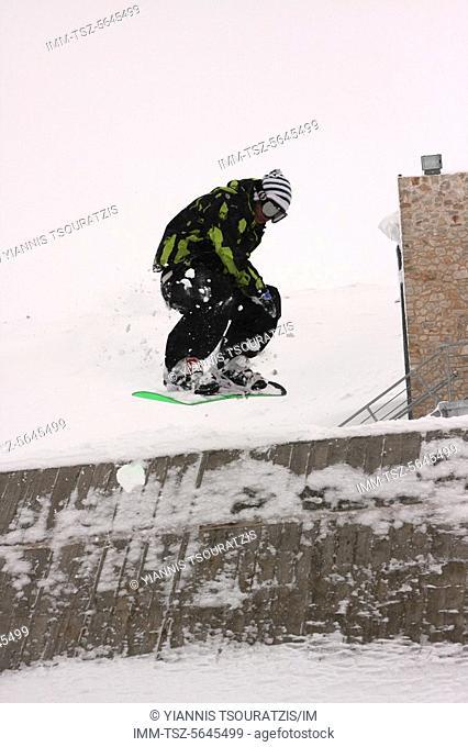 Man doing snowboarding tricks. Kellaria, Parnassos, Arachova, Viotia, Central Greece, Europe