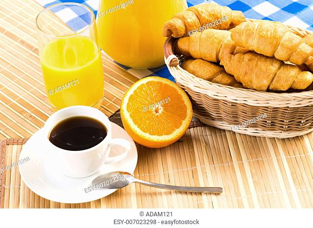 continental breakfast: coffee, orange, croissant and juice