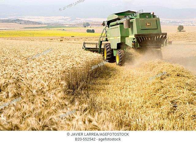 Agricultural machinery. Combine harvester on field of wheat. 'Learza' estate. Near Estella, Navarre, Spain