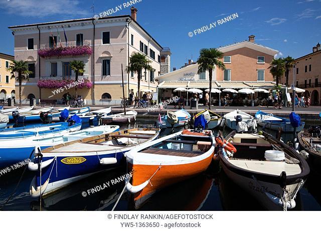 Harbour with small fishing boats in Bardolino, Lake Garda, Italy