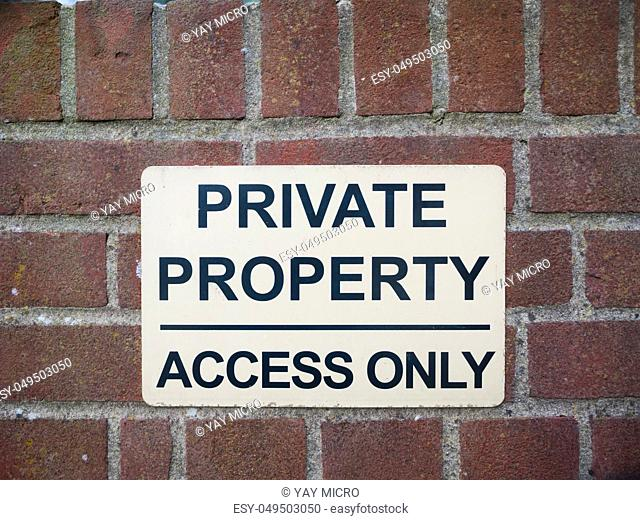 private property access only black and white sign on brick wall close up; essex; england; uk