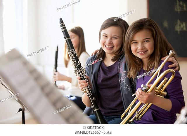 Portrait of smiling Caucasian girls in music class