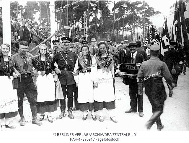 Nuremberg Rally 1933 in Nuremberg, Germany - Women in traditional costumes from Mecklenburg between members of the SA (Sturmabteilung)