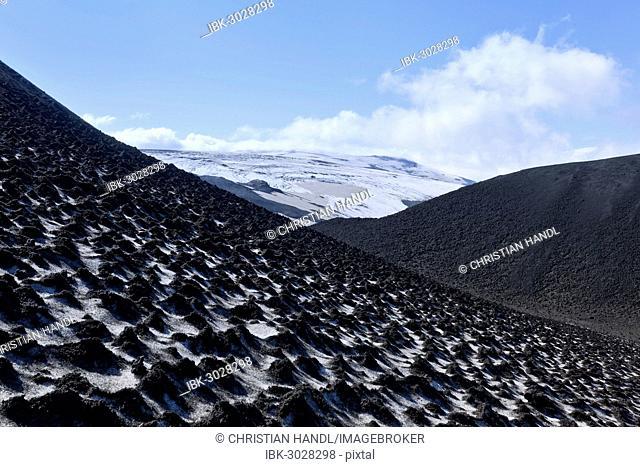 Ash-covered snowfield with the Eyjafjallajökull on the long-distance hiking trail from Skógar via Fimmvörðuhals to the Thórsmörk mountain ridge, Þórsmörk