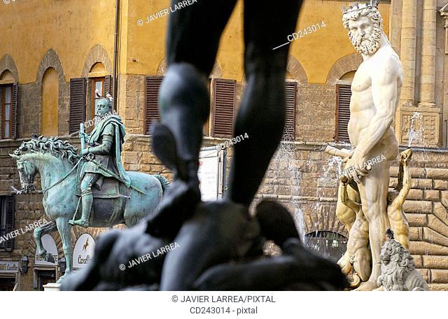 Statue of Cosimo I de Medici by Giambologna and 'Il Biancone', statue of Neptune, in Piazza della Signoria. Florence. Tuscany, Italy