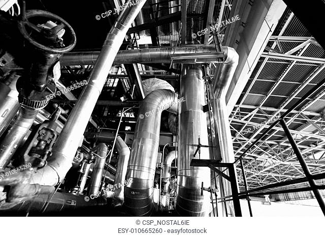 Equipment, cables and piping as found inside of a modern industrial power plant b&w